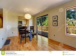 large open space with dining room table and balcony door stock