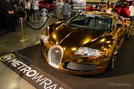 bugatti gold and flo rida wraps his bugatti veyron in gold chrome finish gtspirit