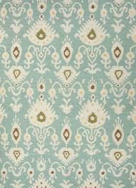 is this rug a true blue or aqua sea foam green color