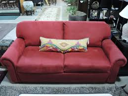 furniture comfortable red hideabed with decorative cushion for