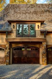 wood garage door with substantial windows let the light arched wood garage door usual house