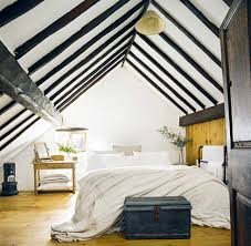 thatched cottage white bedroom with black beams english country
