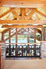 creative log home loft railing with pine tree patterns from black
