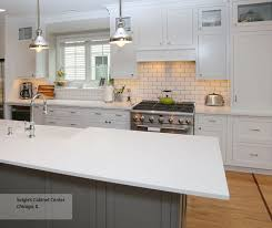 white inset cabinets with a gray kitchen island masterbrand