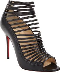 lyst christian louboutin gortika strappy ankle booties in black