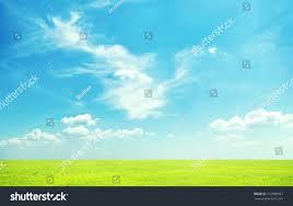 beatiful morning green field blue heaven stock photo 212998387