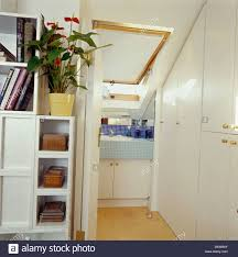 shelving beside folding door to en suite loft conversion bathroom