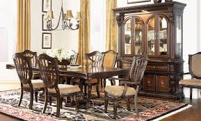 grand estates cinnamon extendable double pedestal dining room set