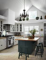 green kitchen cabinets with white island green kitchens are a moment architectural digest