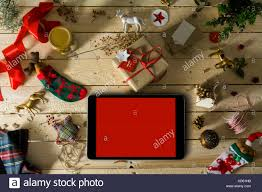 empty tablet surrounded with ornaments and chocolate