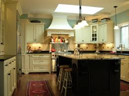 black top white bottom kitchen island with seating and stove