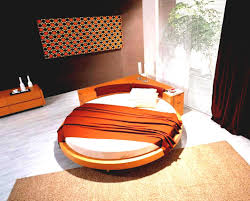 round orange bed frame with headboard and white bed sheet on grey