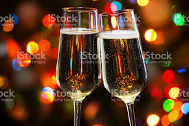 champagne glasses and christmas lights stock photo 496877056 istock