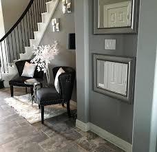 foyer area modern glam foyer black white silver grey spiral staircase mirrors