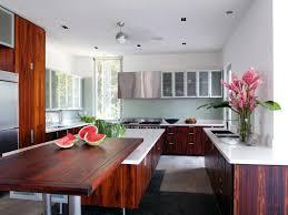 triangular kitchen island dark wood and white combination cupboards with black kitchen