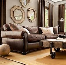 Dark Brown Sofa by Love The Vase And Lanterns Behind The Couch Interior Design