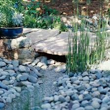 garden project how to create a dry creek from bhg com