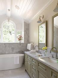 this master bath features a soaking tub surrounded by marble wall