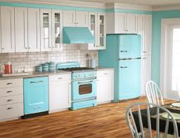 white wooden kitchen cabinet and blue refrigerator on brown wooden