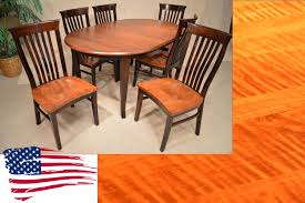 Amish Dining Room Chairs Amish Oval Dining Table And Tiger Maple Side Chairs Jasens Furniture
