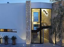 glass entrance wooden front door modern house in ibiza spain