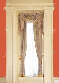 dressed window with curtains in luxury home stock photo picture