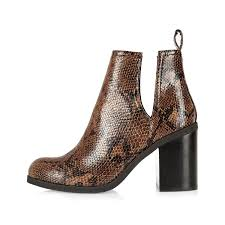 river island womens boots sale river island brown snake print cut out ankle boots lyst