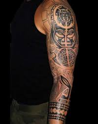 black ink maori on left sleeve