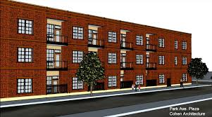 three story apartment building proposed for parking lot in