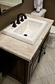 bathroom cream marble vanity countertops with white sink and dark