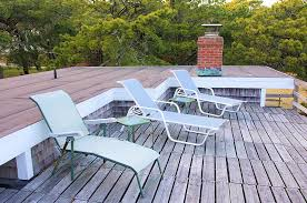 cape cod cottage at surf side roof deck with ocean view