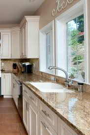 what color countertop with beige cabinets 38 trendy beige granite kitchen countertops ideas