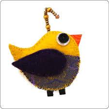 purple and yellow bird ornament by chris metro