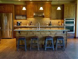 green kitchen islands black pendant light dark wood barstools range hood green kitchen
