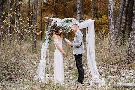 wedding arches made of branches intimate autumnal boho forest elopement weddingomania