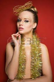 sparkly hair pretty girl with golden shiny creative make up and sparkly tinsel
