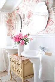classic english cottage look with pink floral wallpaper and creamy