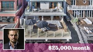 leonardo dicaprio dips his toe in malibu u0027s summer lease market