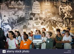 montgomery alabama civil rights memorial center black asian boy montgomery alabama civil rights memorial center black asian boy girl student field trip learn history wall mural exhibit discrim