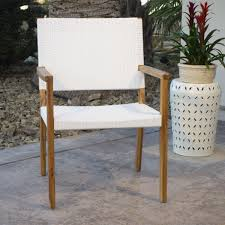 Outdoor Dining Area With No Chairs Combining Woven White All Weather Wicker And Acacia Wood Our