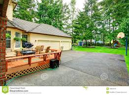 backyard patio area with basketball court stock photo image