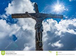 statue of jesus christ on the cross in the dolomites stock photo