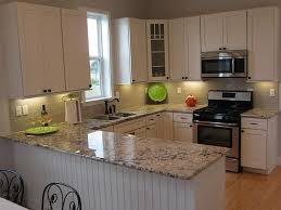 granite colors for white kitchen cabinets kitchen w stainless steel appliances and alaskan white granite