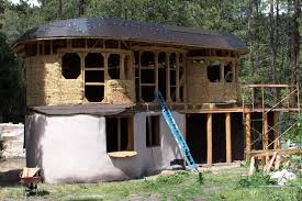 2 story curved straw bale walls earthen touch natural builders