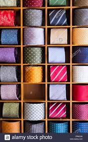 display of colourful mens u0027 ties rolled and set between wooden