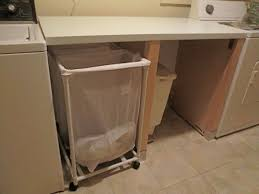 Small Laundry Room Storage Solutions by Interior Brown Wooden Laundry Pull Down Table On Basket Shelf
