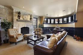 elegant basement living room space with curved wall homeyou