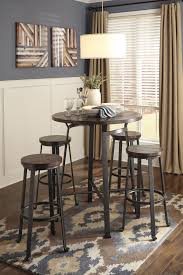 Round Dining Room Table Signature Design By Ashley Challiman Industrial Style Round Dining