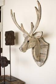 the recycled wooden deer wall hangingwill give an eye