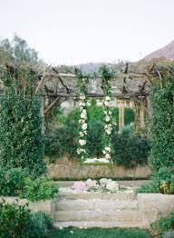 ceremony décor photos floral swing under trellis inside weddings